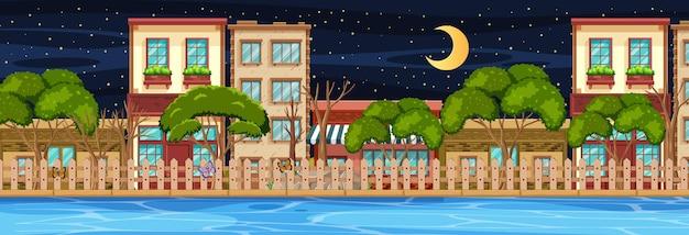 Many buildings along the river horizontal scene at night