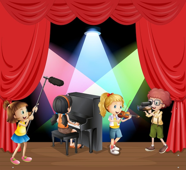 무대에서 음악을 연주하는 많은 아이들