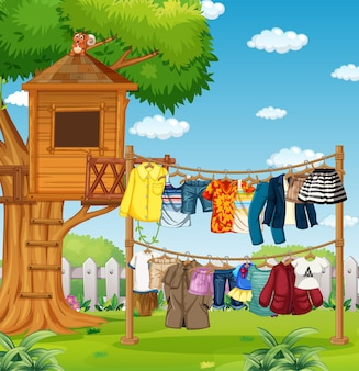 Many clothes hanging on a line outside the house