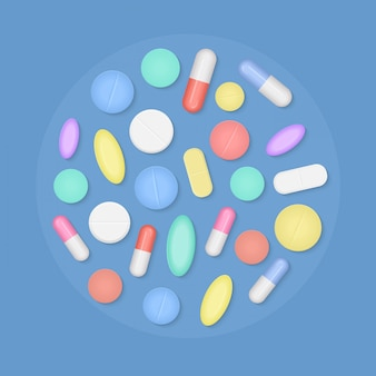 Many colorful medicine pills top view isolated.