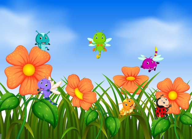 花畑で飛んでいる多くの昆虫