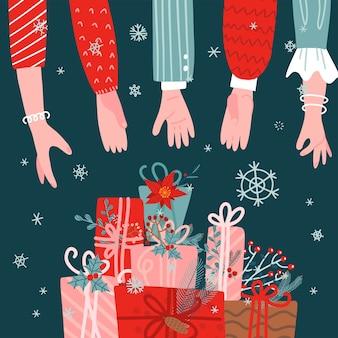 많은 사람들이 녹색 배경에 선물 상자 스택에 도달 손. 크리스마스 선물 인사말 카드.