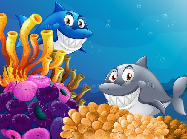 水中の背景に多くのサメの漫画のキャラクター