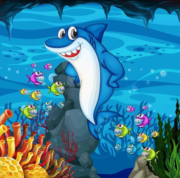 Molti personaggi dei cartoni animati di squali sullo sfondo sott'acqua