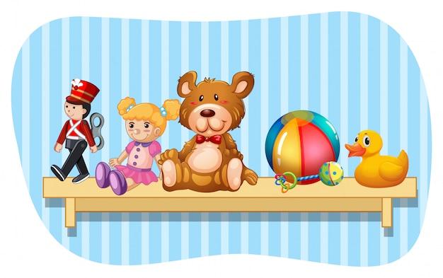 Many types of toys on wooden shelf