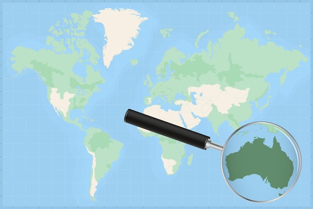Map of the world with a magnifying glass on a map of australia.