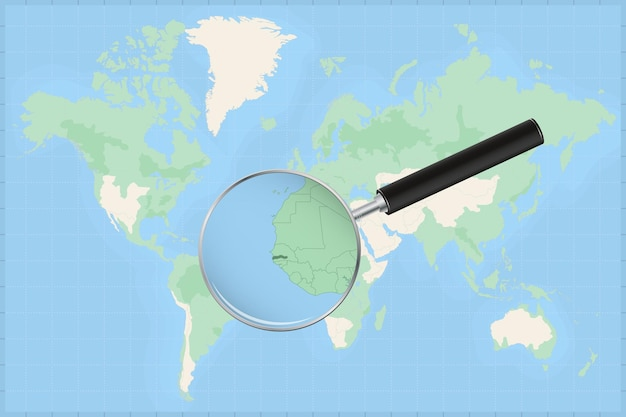 Map of the world with a magnifying glass on a map of gambia.