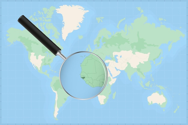 Map of the world with a magnifying glass on a map of guinea-bissau.