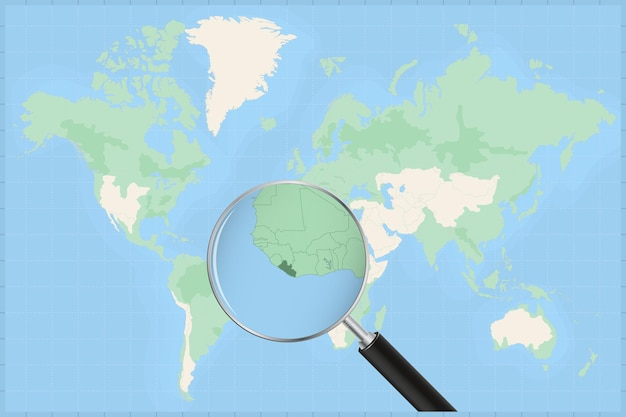 Map of the world with a magnifying glass on a map of liberia.