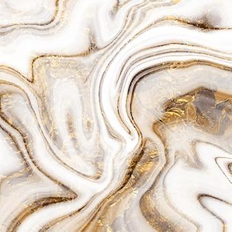金色の抽象的なストロークラインと大理石のテクスチャデザイン
