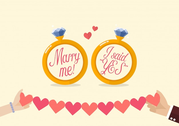 Marry me and i said yes with hands holding line paper of hearts