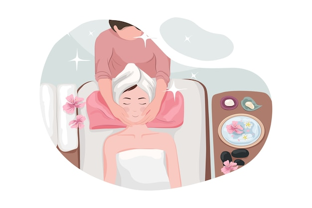 Массажист делает массаж женского тела в спа-салоне