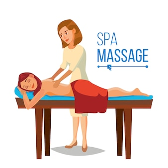 Masseuse giving massage to a woman