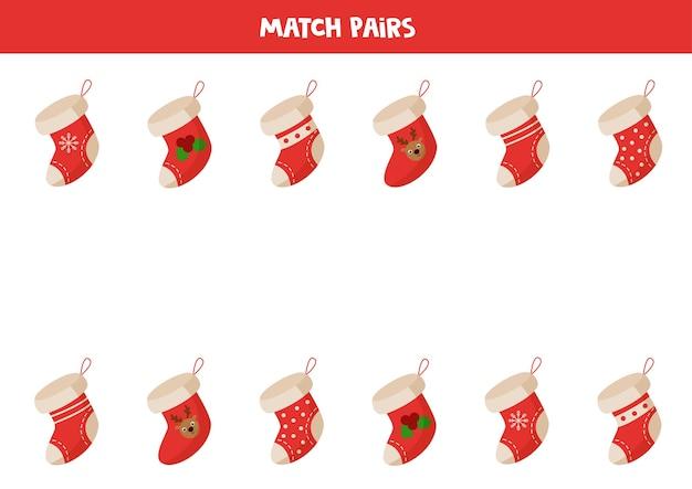 크리스마스 양말과 일치합니다. 각 양말에 맞는 쌍을 찾으십시오. 아이들을위한 논리 게임.