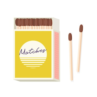 Matchbox and pair of wooden matches lying beside it isolated on white background