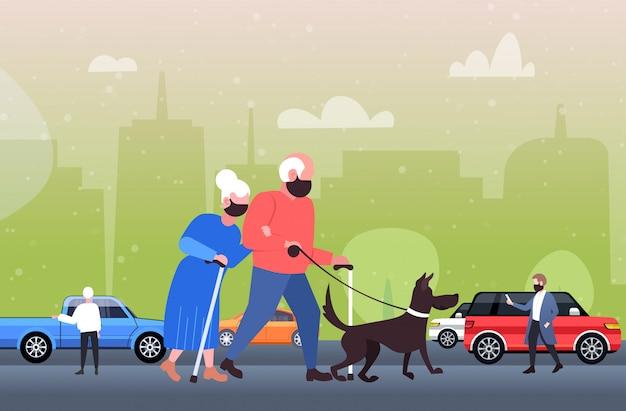 Mature couple walking with dog senior man woman wearing mask to prevent coronavirus pandemic