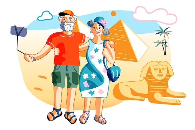 성숙한 부부 관광객은 이집트 피라미드를 방문합니다. 이집트 관광 명소와 함께 전화 카메라로 셀카를 찍는 노인과 노부. 은퇴와 관광. 펜션 여행. 벡터
