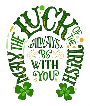 May the luck of the irish always be with you - hand drawn st patrick's day lettering phrase, horseshoes shape design.