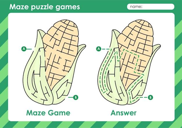 果物と野菜の絵のトウモロコシを持つ子供のための迷路パズルゲーム活動