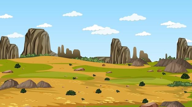 昼間の牧草地の森の風景