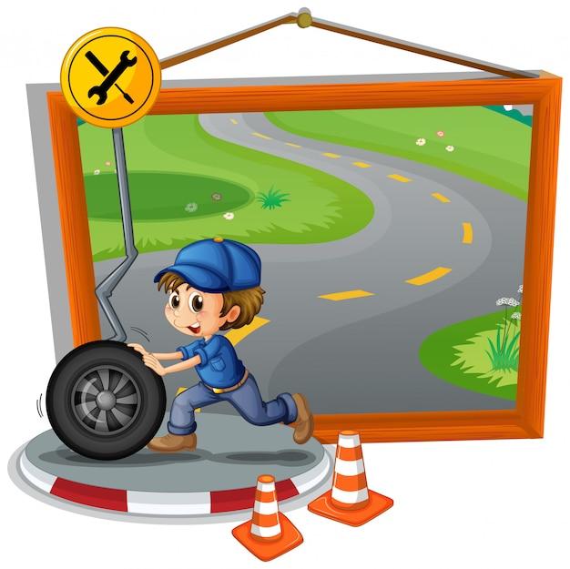 Mechanic rolling wheel on the road