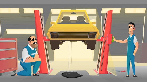 Mechanics in vehicle auto workshop repairs car.