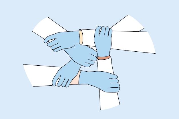 医療チームワーク、医療従事者の団結の概念。保護手袋をはめた医師の手が互いにグローバルな医療パートナーシップを保持し、covid-19のパンデミックに対する取り組みを統合します