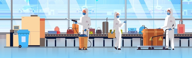 Medical workers in hazmat suits cleaning disinfecting baggage conveyor belt at airport coronavirus epidemic mers-cov virus concept wuhan 2019-ncov pandemic health risk full length horizontal