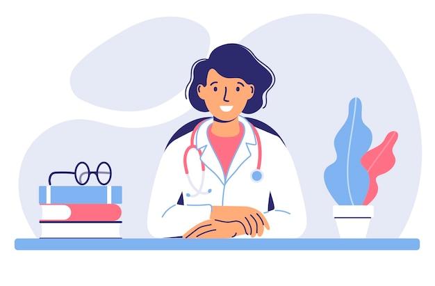 Концепция медицины с доктором молодая женщина-врач сидит за столом в медицинском кабинете больницы
