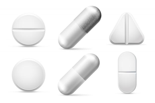 Лекарства круглые белые таблетки, аспирин, антибиотики, витамины и обезболивающие препараты.