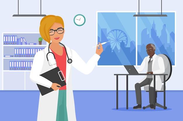 ラップトップで作業している注射器の医者を保持している病院の女性看護師の医学チームワーク