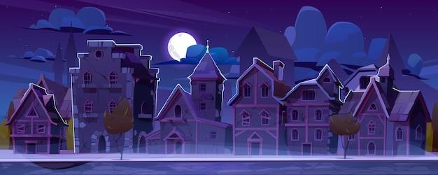 夜に木造家屋が並ぶ中世のドイツの通り