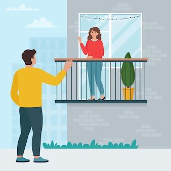 Встреча близких возле дома. мужчина пришел к любимой под балкон. концепция празднования годовщины, свиданий или дня святого валентина во время пандемии