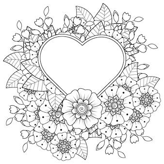 민족 오리엔탈 스타일 낙서 장식 색칠 공부 페이지에서 심장 모양의 프레임 멘디 꽃