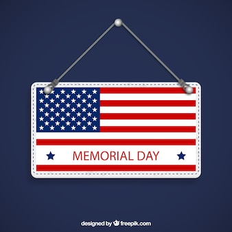 Memorial day sign hanging on a rope