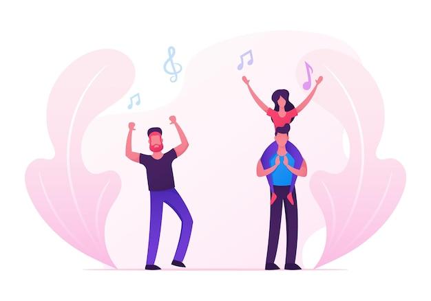 男性と女性のファンが手を上げて応援、ダンス、ジャンプ