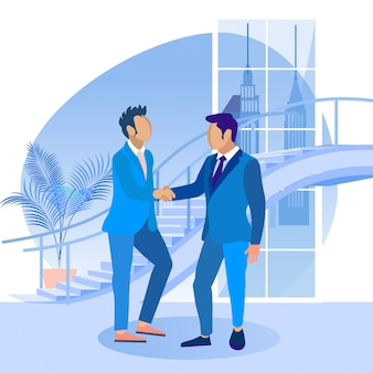 Men in blue business suits shake hands ealch other