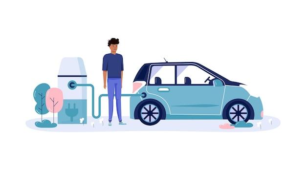 男性はエコカー、公共公園での都市交通を充電して運転します。個人の電気輸送、グリーン電気輸送。白で隔離される生態学的な乗り物