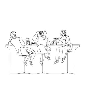 男性はビールを飲み、アルコールバーで話す