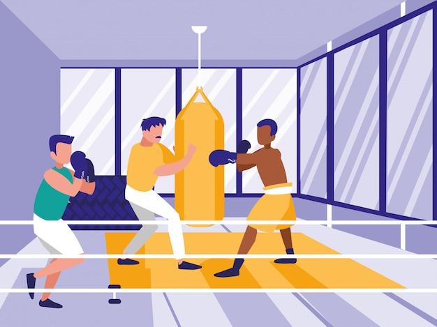 Men practicing boxing in gym