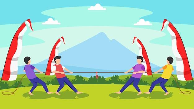 インドネシアの独立記念日を祝うためにロープゲームを引っ張る男性