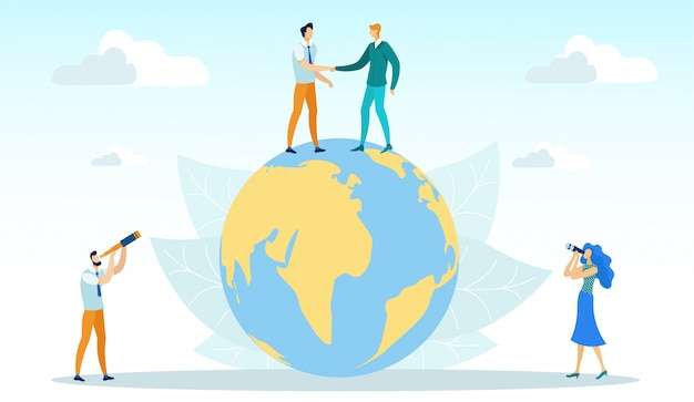 Men shaking hands standing on globe, business