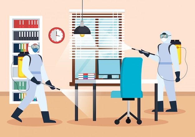 Men with protective suits spraying office