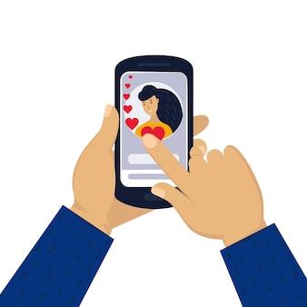 Мужская рука держит телефон с женским портретом онлайн-любовный чат в интернете