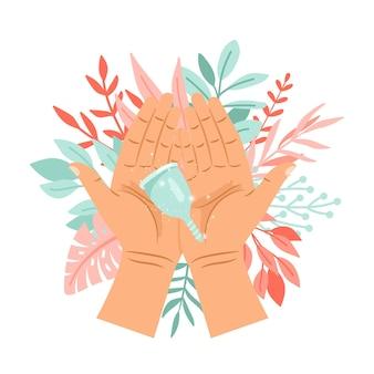 女性の手に月経カップ
