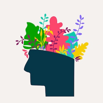 Mental health concept abstract image of head with flowers inside