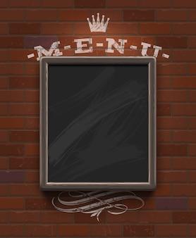 ヴィンテージのレンガの壁に木製フレームのメニュー黒板