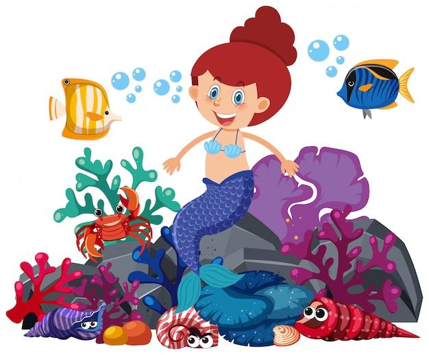 Mermaid sitting on rock with fish swimming around