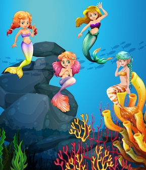 Mermaids swimming under the ocean