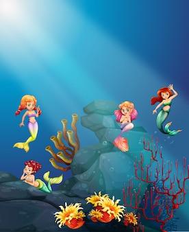 Русалки плавают под океаном
